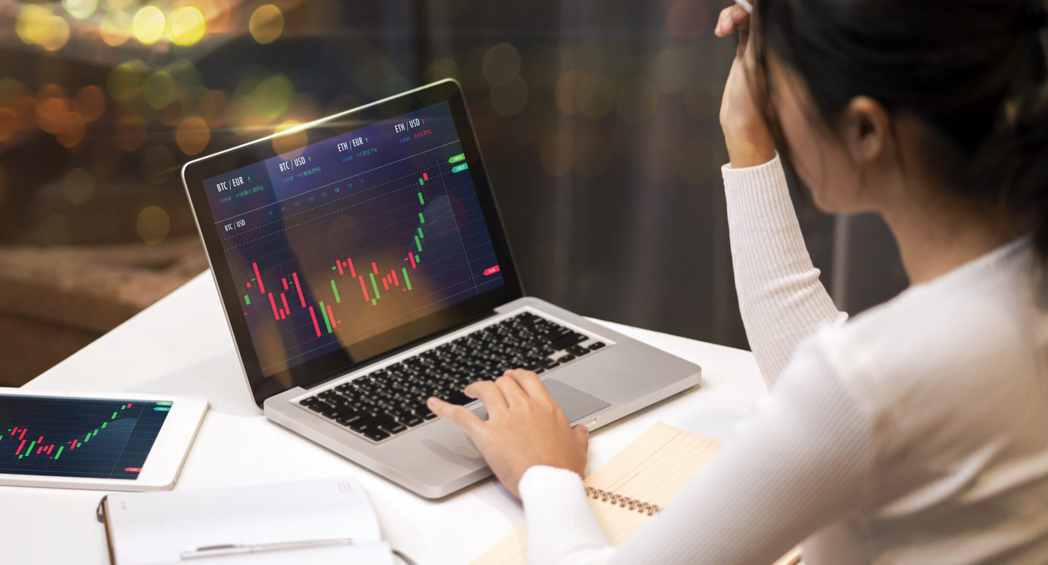 A woman researching the best stocks under $20.